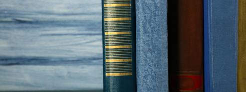 Stack of books with blue background